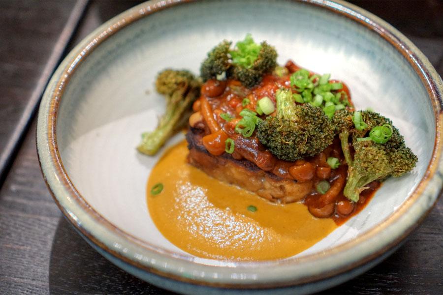 Pretzel bread pudding with mushroom chili, broccoli and spicy squash spread