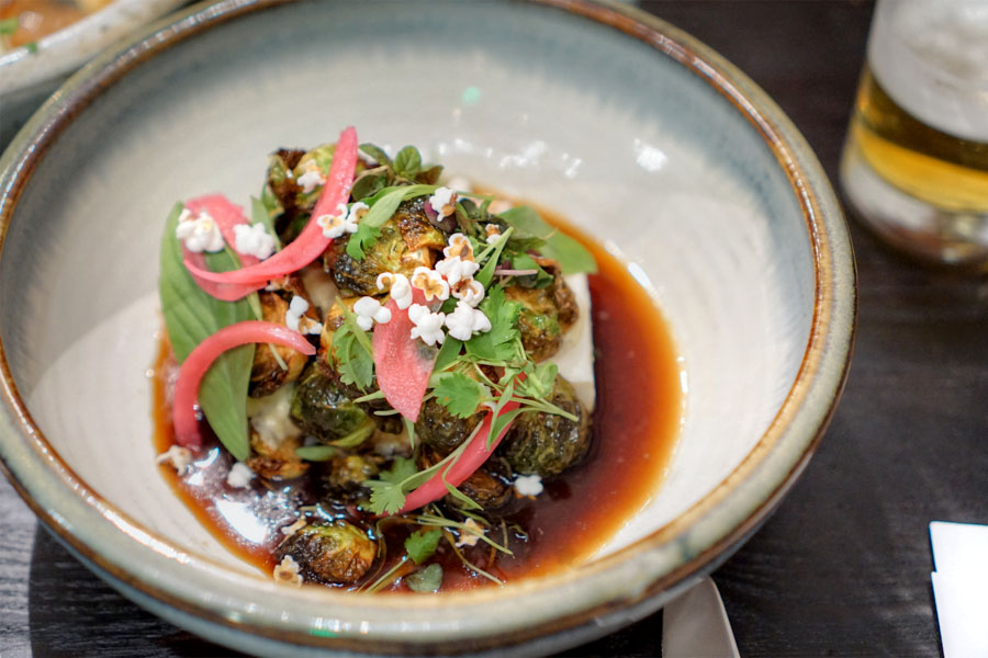 Soft tofu with brussels sprouts, pickled garlic ponzu, lime cured onion and popcorn