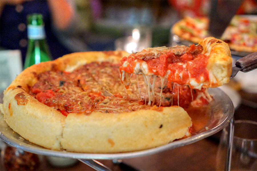 Small Traditional Deep Dish Pizza (Lifting a Slice)