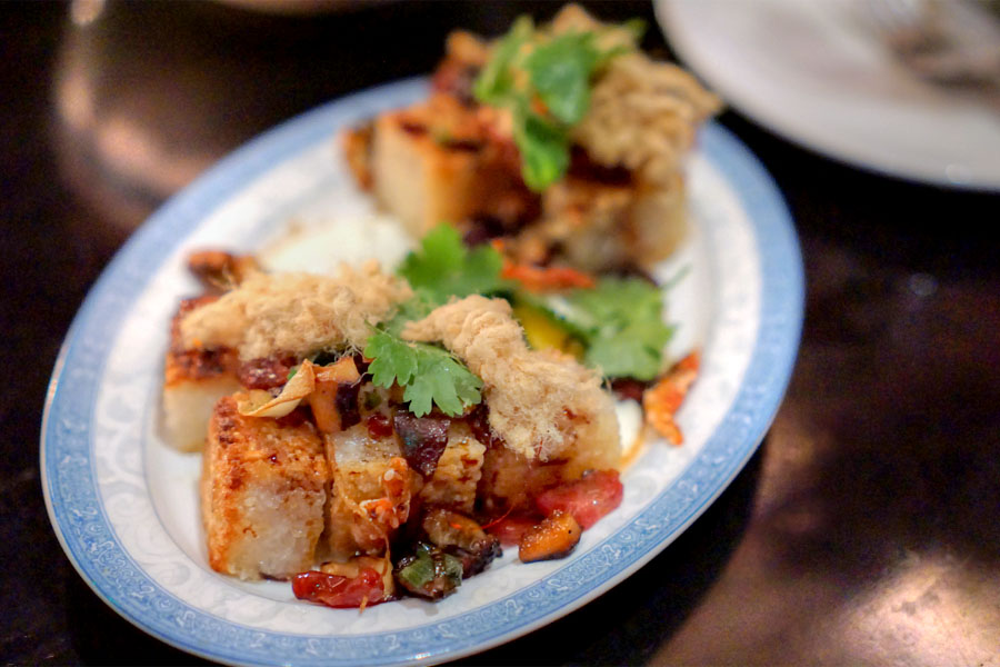 'xio' sticky rice, lap cheung, pork floss, crispy shallots, slow egg, roasted chili vinegar
