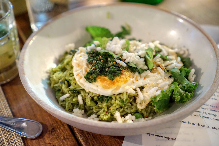 Green piri-piri rice with peas, asparagus, over-easy egg, crispy rice, lime zest and soft herbs