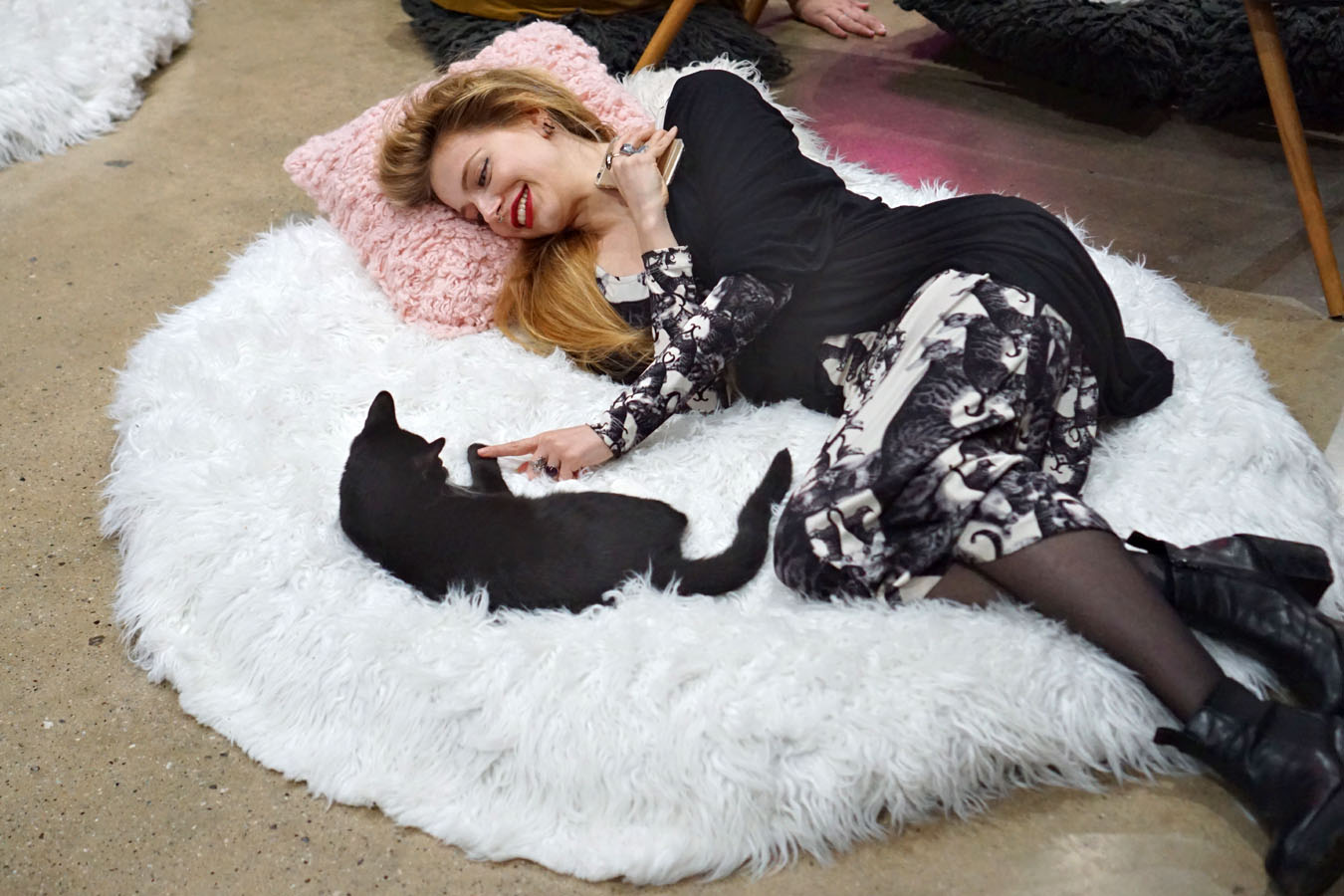 Cat and woman on a fluffy cushion
