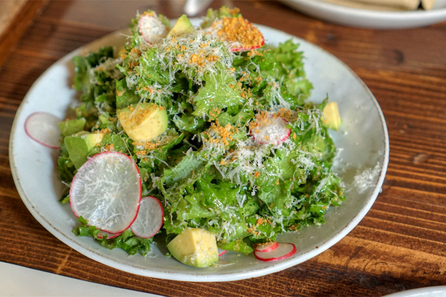 Siberian kale, avocado, radish, sheep's cheese, lemon, anchovy bread crumbs
