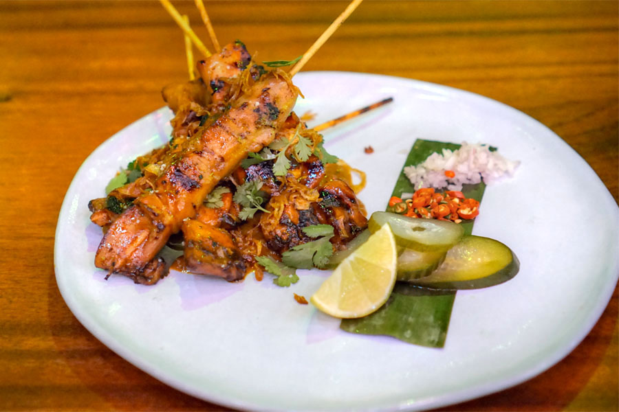 Sate ayam, sweet soy glazed grilled chicken skewers with our signature peanut sauce