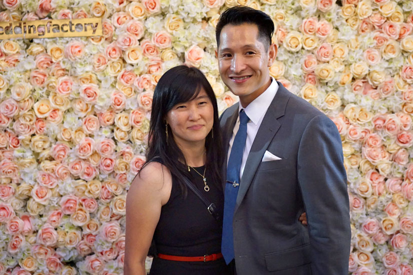 Couple in Front of Flower Wall
