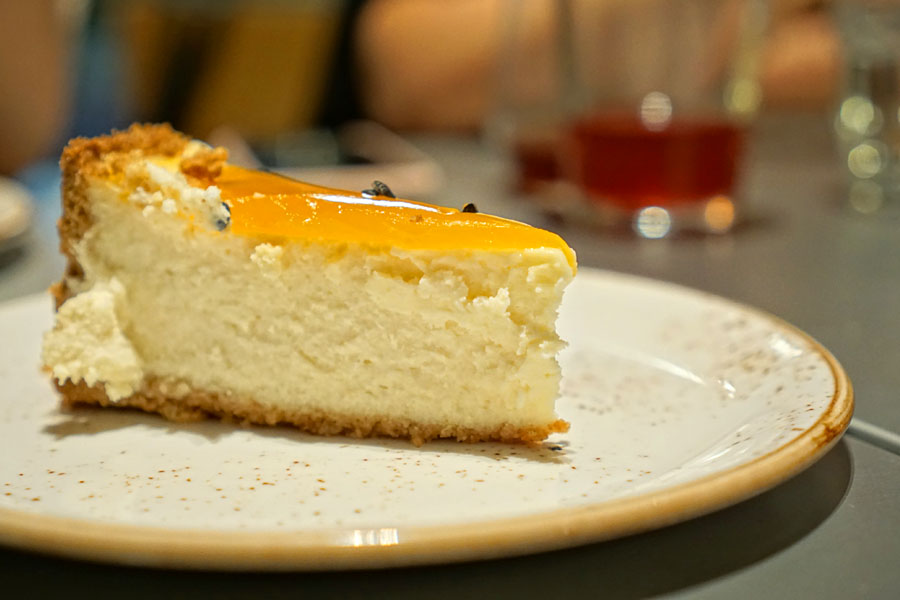coconut cheesecake with passion fruit - sliced