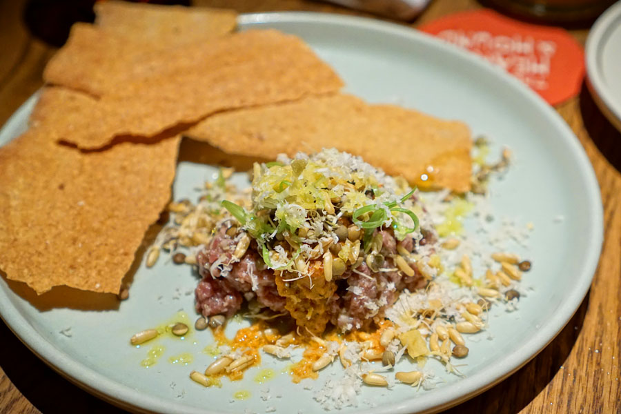 Beef Tartare with Harissa + Sprouted Lentils