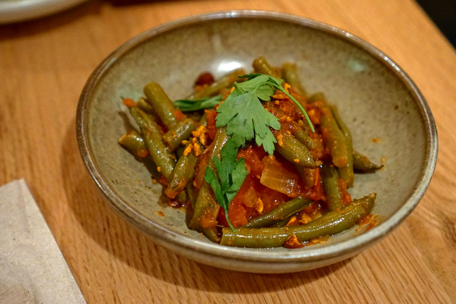 Green beans simmered in spicy tomato sauce