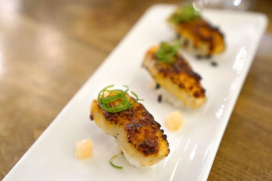 pork toro nigiri, doubanjiang, crispy rice, shiso, young ginger