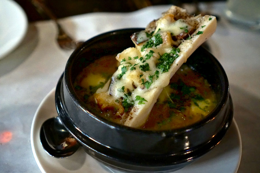 Soupe à l'oignon, French onion soup, bone marrow, raclette, chopped parsley