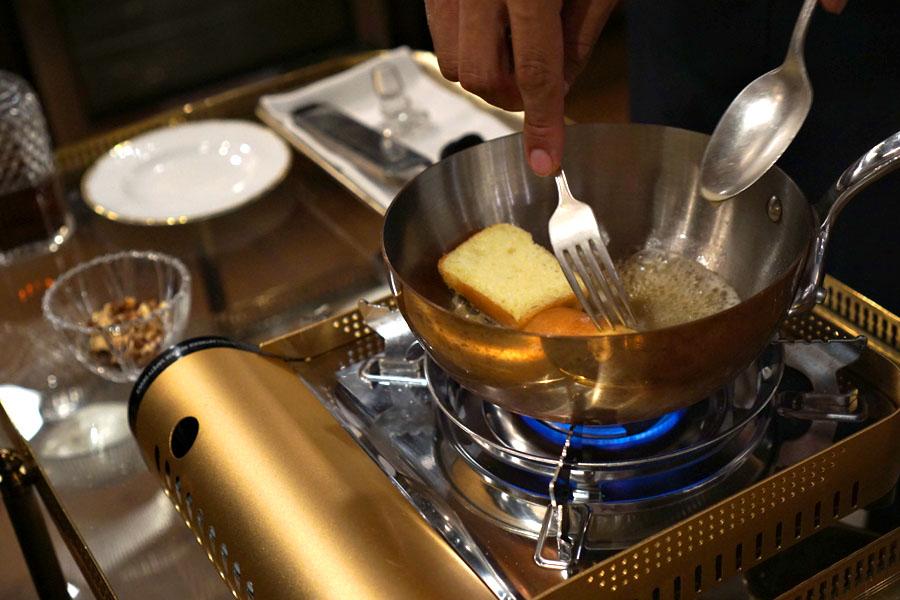 Tableside baba au rhum preparation