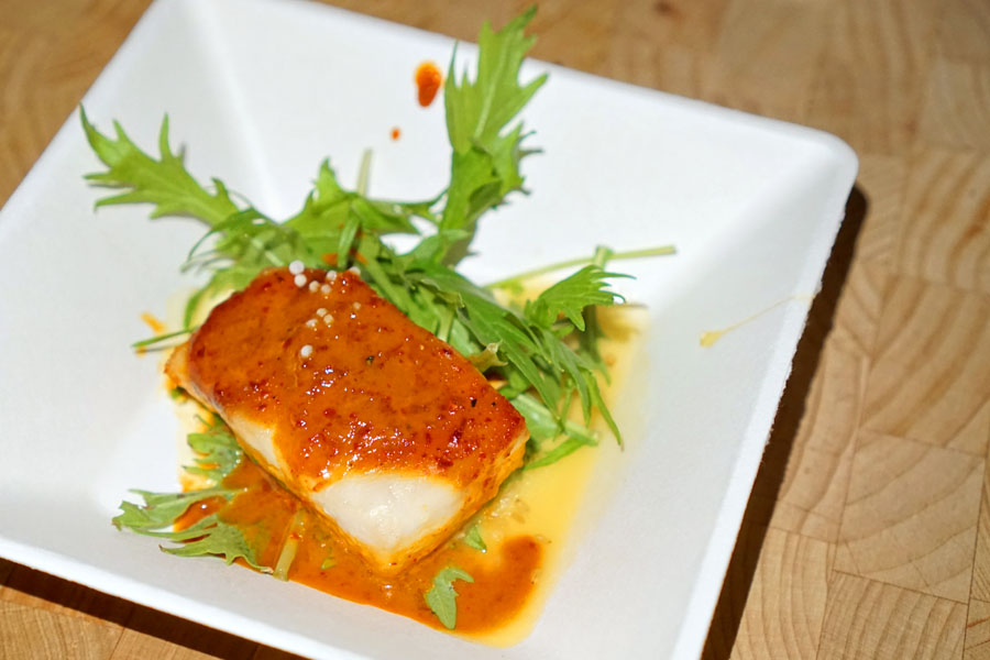 Gochujang Glazed Sea Bass with Local Greens and Toasted Sesame Vinaigrette