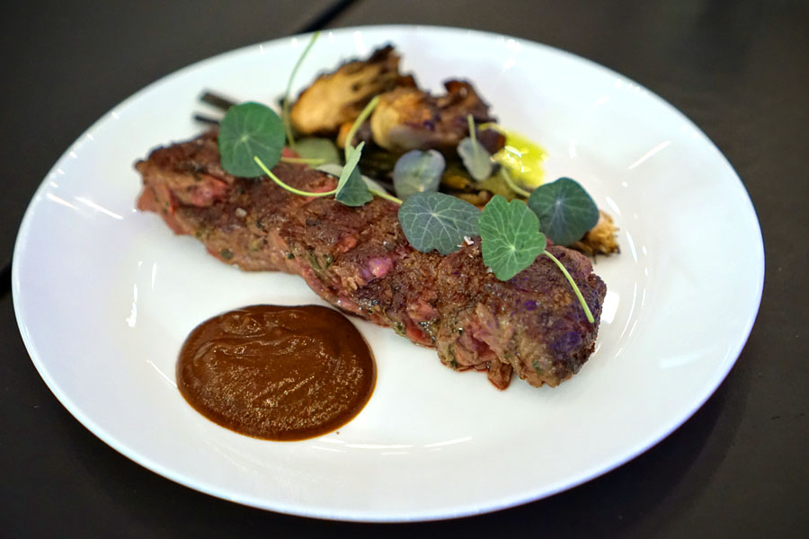 hanger steak, sautéed scallions, maitake mushrooms, steak sauce, nasturtium pesto