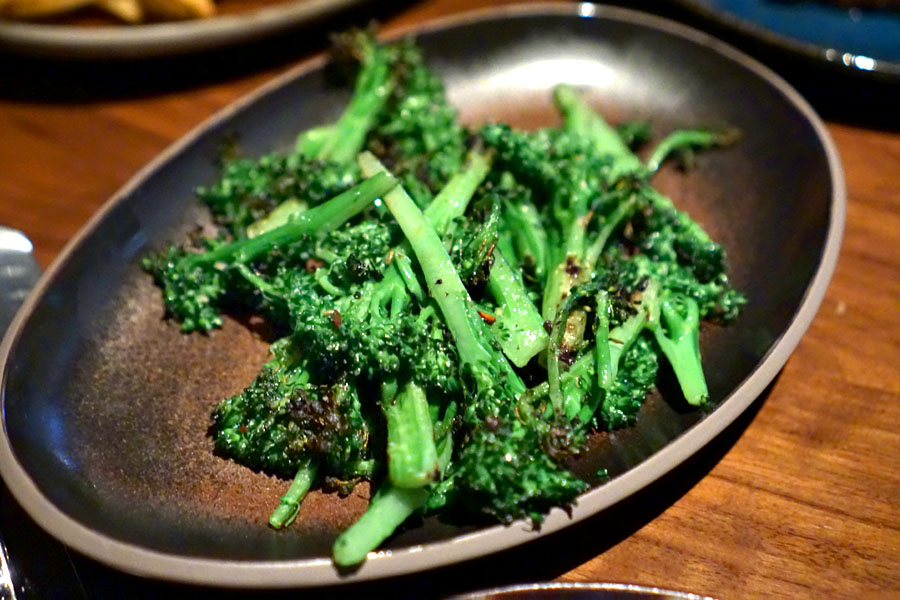 Broccolini with garlic and red pepper flakes cooked over the wood fire