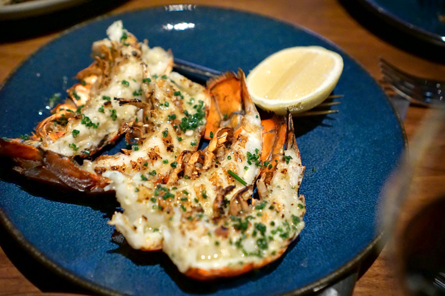 Lobster Tails cooked over the wood fire with yuzu-kosho garlic butter